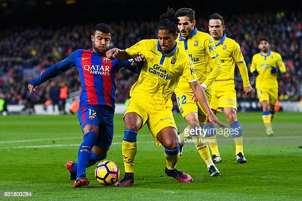 Rafinha Alcantara of FC Barcelona competes for the ball with UD Las Palmas players during the La Liga match between FC Barcelona and UD Las Palmas at...