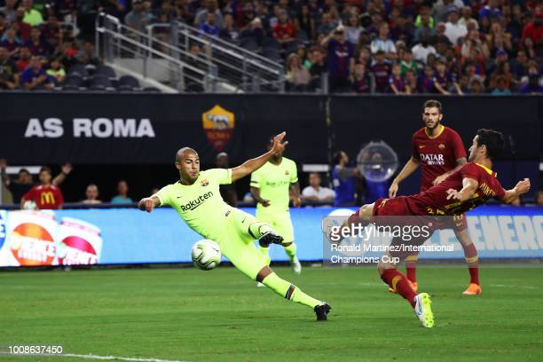Rafinha Alcantara of FC Barcelona scores a goal as Ivan Marcano of AS Roma defends during their International Champions Cup 2018 match at ATT Stadium...