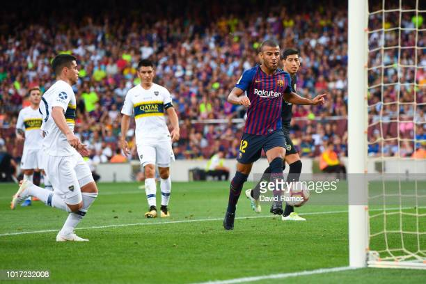Rafinha Alcantara of FC Barcelona scores his team's third goal during the Joan Gamper Trophy match between FC Barcelona and Boca Juniors at Camp Nou...