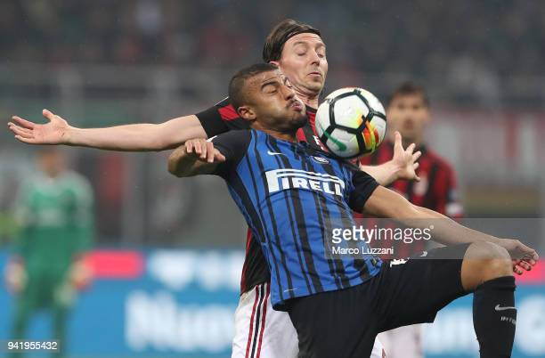 Rafinha Alcantara of FC Internazionale competes for the ball with Riccardo Montolivo of AC Milan during the Serie A match between AC Milan and FC...