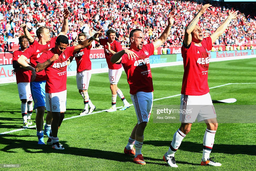 Rafinha (front) and team mates of Muenchen celebrate their team's fourth consequtive German Championship after the Bundesliga match between FC Imgolstadt and FC Bayern Muenchen at Audi Sportpark on May 07, 2016 in Ingolstadt, Bavaria.