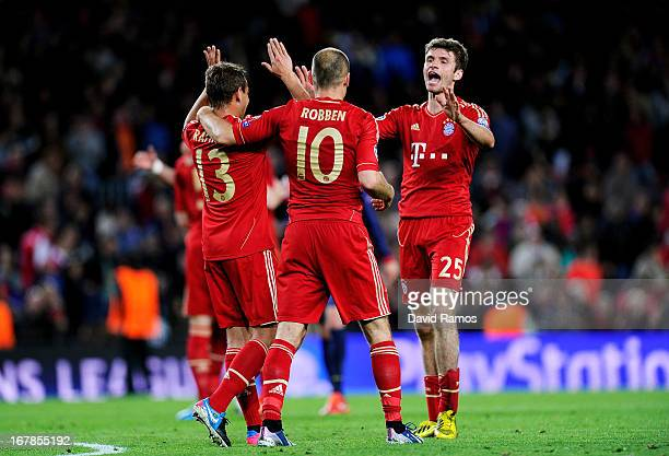 Rafinha Arjen Robben and Thomas Muller of Munich celebrate reaching the final following their team's 30 victory during the UEFA Champions League semi...