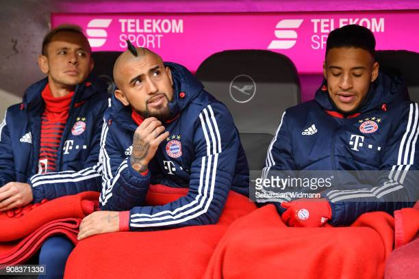 Rafinha Arturo Vidal and Corentin Tolisso of Bayern Muenchen sit on the bench prior to the Bundesliga match between FC Bayern Muenchen and SV Werder...