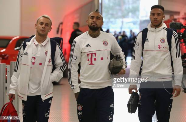 Rafinha Arturo Vidal and James Rodriguez of FC Bayern Muenchen arrive at the players' tunnel for the Bundesliga match between FC Bayern Muenchen and...