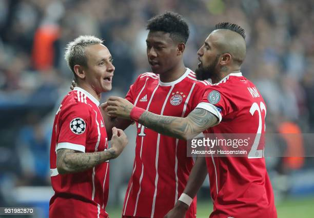 Rafinha David Alaba and Arturo Vidal of Bayern Muenchen celebrate as Gokhan Gonul of Besiktas scores their second goal with an own goal during the...