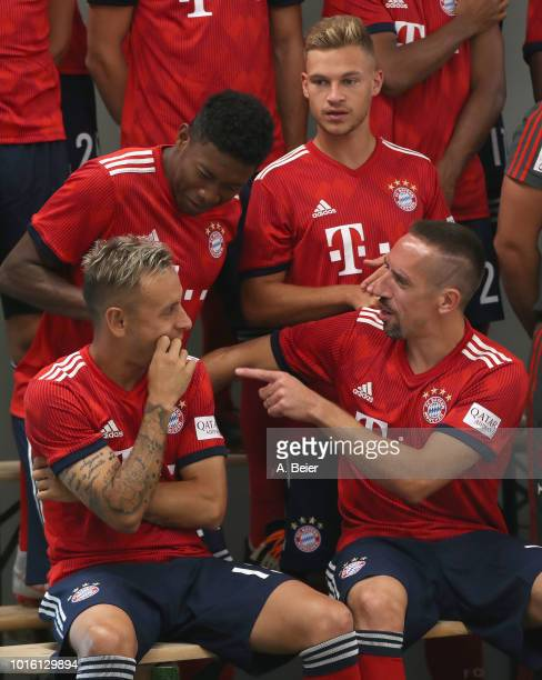 Rafinha David Alaba Franck Ribery and Joshua Kimmich of FC Bayern Muenchen joke during the team presentation at on August 13 2018 in Munich Germany