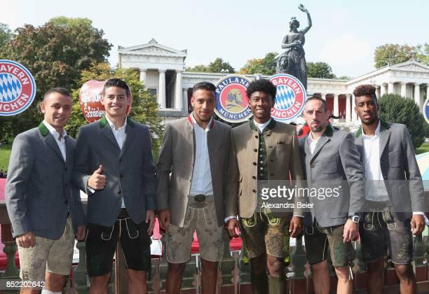 Rafinha James Rodriguez Corentin Tolisso David Alaba Franck Ribery and Kingsley Coman of FC Bayern Muenchen attend the Oktoberfest beer festival at...
