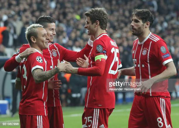 Rafinha James Rodriguez Thomas Mueller and Javi Martinez of Bayern Muenchen celebrate as Gokhan Gonul of Besiktas scores their second goal with an...