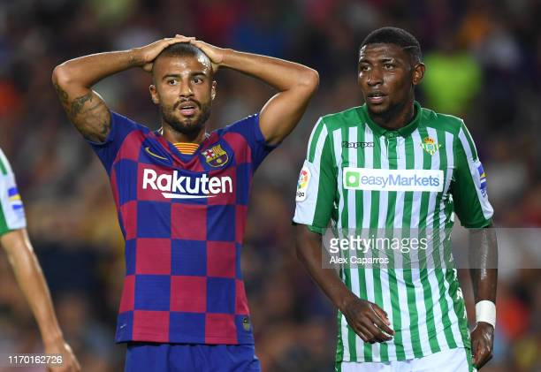 Rafinha of Barcelona and Emerson de Souza of Real Betis look on during the Liga match between FC Barcelona and Real Betis at Camp Nou on August 25...