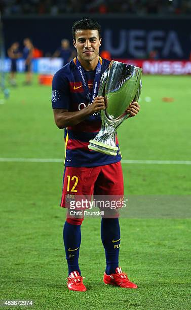 Rafinha of Barcelona celebrates with the UEFA Super Cup after the UEFA Super Cup between Barcelona and Sevilla FC at Dinamo Arena on August 11 2015...