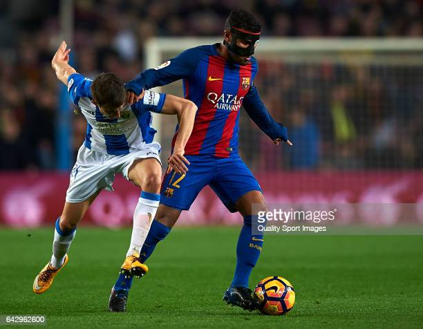 Rafinha of Barcelona competes for the ball with Alexander Szymanowski of Leganes during the La Liga match between FC Barcelona and CD Leganes at Camp...