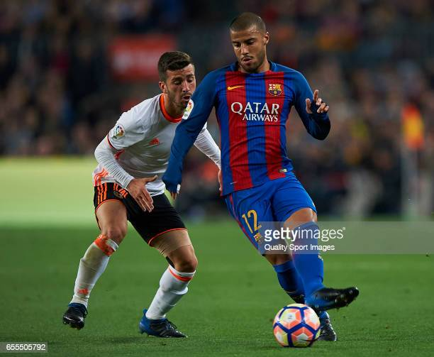 Rafinha of Barcelona competes for the ball with Jose Luis Gaya of Valencia during the La Liga match between FC Barcelona and Valencia CF at Camp Nou...