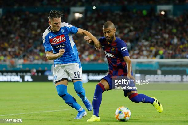 Rafinha of Barcelona fights for the ball with Piotr Zielinski of Napoli during the second half of a preseason friendly match at Hard Rock Stadium on...