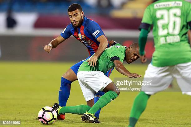 Rafinha of Barcelona in action against Luiz Carlos of Al-Ahli Saudi during a friendly soccer match between Al-Ahli Saudi and Barcelona at Al-Gharrafa...