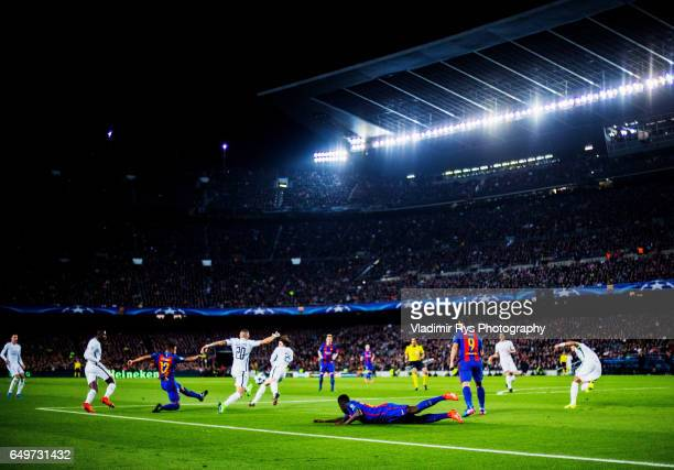 Rafinha of Barcelona passes the ball defende by Layvin Kurzawa and Adrien Rabiot of PSG during the UEFA Champions League Round of 16 second leg match...