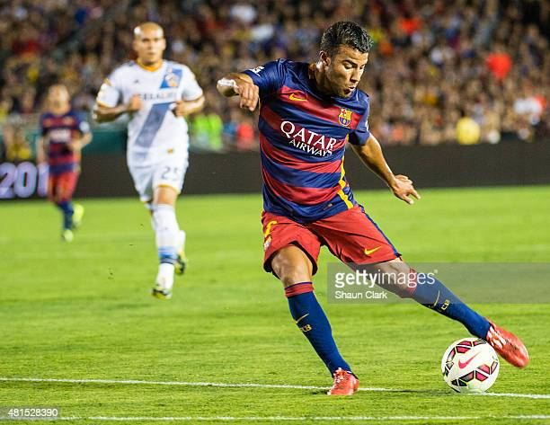 Rafinha of Barcelona takes a shot during the International Champions Cup 2015 match between FC Barcelona and Los Angeles Galaxy at the Rose Bowl on...