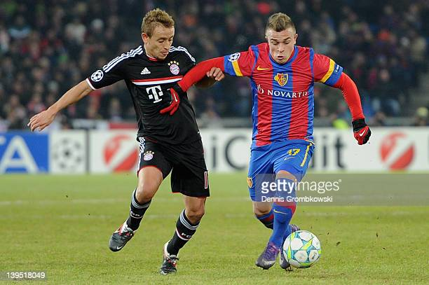 Rafinha of Bayern challenges Xherdan Shaqiri of Basel during the UEFA Champions League round of sixteen first leg match between FC Basel 1893 and FC...