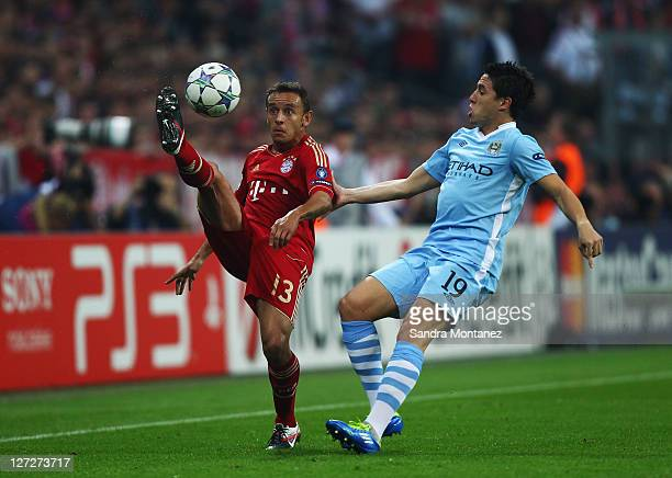 Rafinha of Bayern is challenged by Samir Nasri of Manchester City during the UEFA Champions League group A match between FC Bayern Muenchen and...