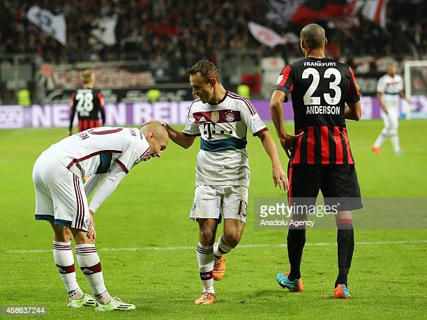 Rafinha of Bayern München celebrates Robben of Bayern München during the Bundesliga soccer match between Eintracht Frankfurt and Bayern München at...