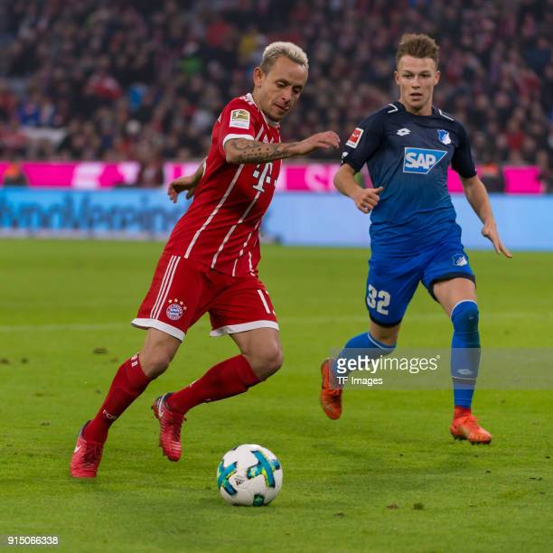Rafinha of Bayern Muenchen and Dennis Geiger of Hoffenheim battle for the ball during the Bundesliga match between FC Bayern Muenchen and TSG 1899...