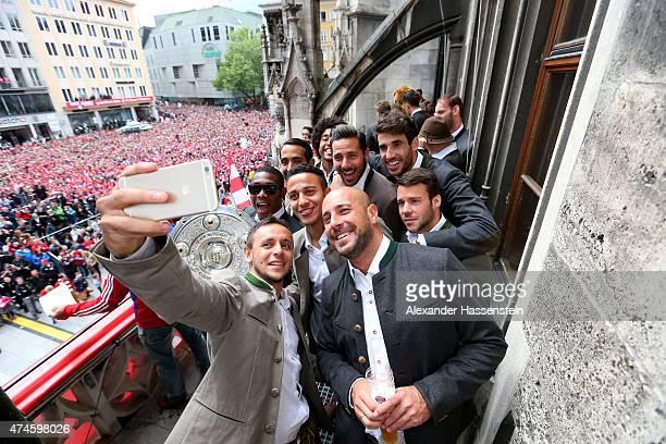 Rafinha of Bayern Muenchen and his team mates David Alaba, Medhi Benatia, Tiago, Dante, Pepe Reina, Claudio Pizarro, Javier Martinez and Juan Bernat...