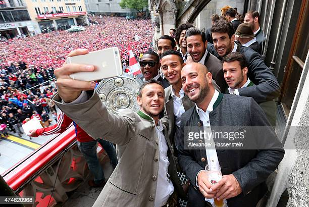 Rafinha of Bayern Muenchen and his team mates David Alaba Medhi Benatia Tiago Dante Pepe Reina Claudio Pizarro Javier Martinez and Juan Bernat as the...