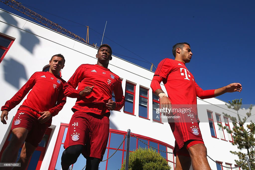 Rafinha (L) of Bayern Muenchen arrives with his team mates David Alaba and Thiago (R) for a training session at Bayern Muenchen's trainings ground Saebener Strasse on October 2, 2015 in Munich, Germany.