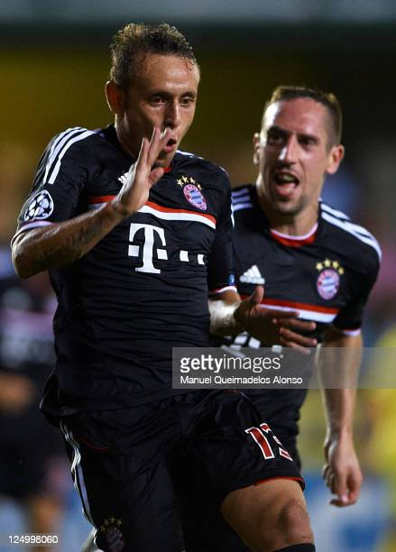 Rafinha of Bayern Muenchen celebrates after scoring with his teammate Franck Ribery during the UEFA Champions League group A match between Villarreal...