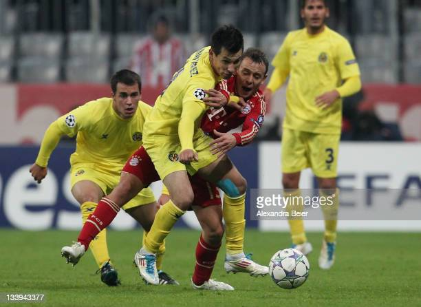 Rafinha of Bayern Muenchen fights for the ball with Hernan Perez of Villareal during the UEFA Champions League group A match between FC Bayern...