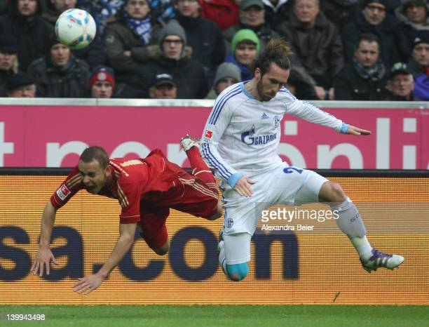 Rafinha of Bayern Muenchen is fouled by Christian Fuchs of Schalke during the Bundesliga match between FC Bayern Muenchen and FC Schalke 04 at...
