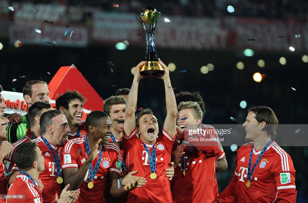 Rafinha of Bayern Muenchen lifts the trophy following the FIFA Club World Cup Final match between Bayern Muenchen and Raja Casablanca at Marrakech Stadium on December 21, 2013 in Marrakech, Morocco.