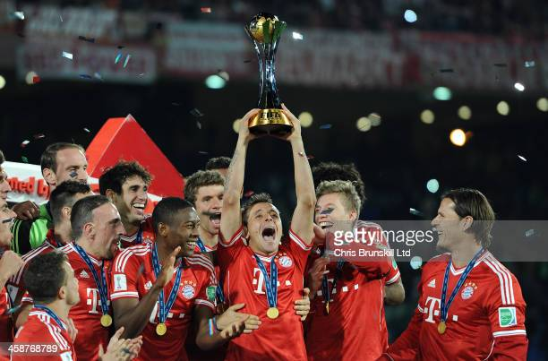 Rafinha of Bayern Muenchen lifts the trophy following the FIFA Club World Cup Final match between Bayern Muenchen and Raja Casablanca at Marrakech...