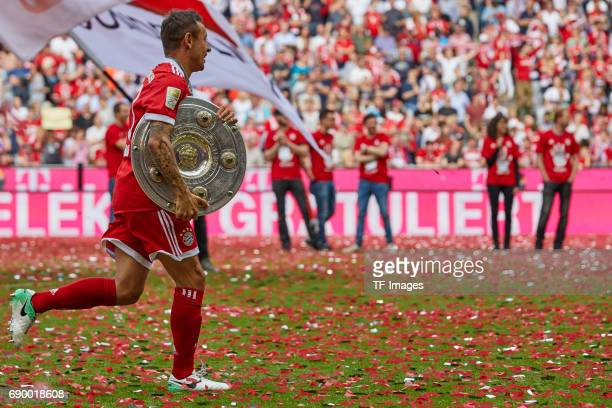 Rafinha of Bayern Muenchen poses with the Championship trophy in celebration of the 67th German Championship title following the Bundesliga match...