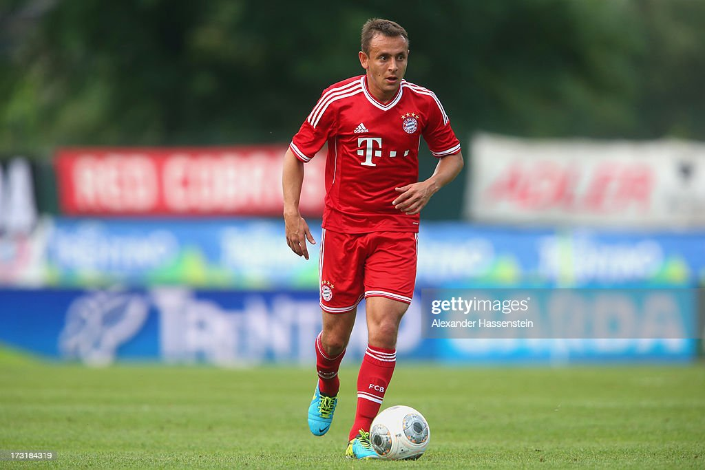 Rafinha of Bayern Muenchen runs with ball during the friendly match between Brescia Calcio and FC Bayern Muenchen at Campo Sportivo on July 9, 2013 in Arco, Italy.