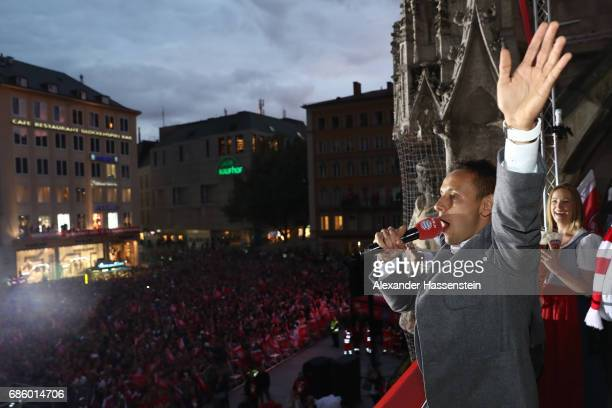 Rafinha of Bayern Muenchen speaks to the fans as they celebrate winning the 67th German Championship title on the town hall balcony at Marienplatz on...