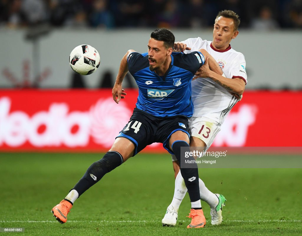 Rafinha of Bayern Munich challenges Sandro Wagner of 1899 Hoffenheim during the Bundesliga match between TSG 1899 Hoffenheim and Bayern Muenchen at Wirsol Rhein-Neckar-Arena on April 4, 2017 in Sinsheim, Germany.