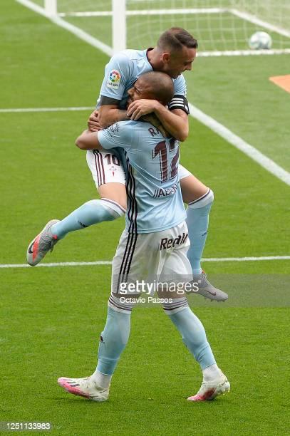 Rafinha of Celta Vigo celebrates after scoring his team's fourth goal with his teammates during the Liga match between RC Celta de Vigo and Deportivo...