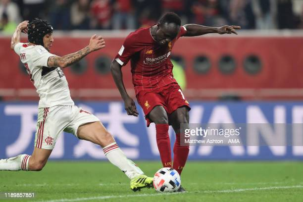 Rafinha of CR Flamengo brings down Sadio Mane of Liverpool during the FIFA Club World Cup Qatar 2019 Final match between Liverpool FC and CR Flamengo...