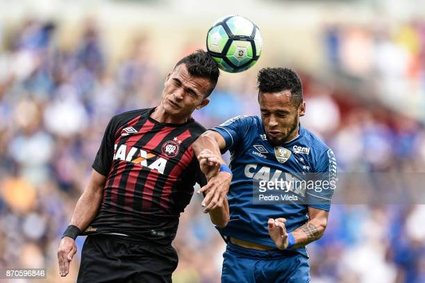 Rafinha of Cruzeiro and Lucas Fernandes of Atletico PR battle for the ball during a match between Cruzeiro and Atletico PR as part of Brasileirao...