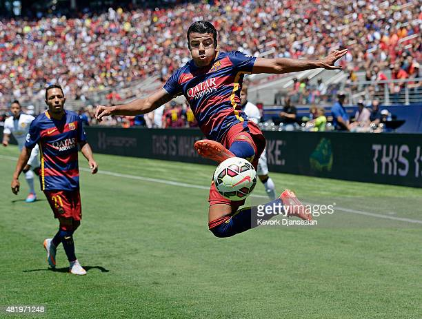 Rafinha of FC Barcelona attempts to save the ball before it goes out of bounds during the first half against Manchester United in the International...