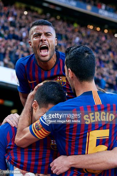 Rafinha of FC Barcelona celebrates a goal with his teammates Luis Suarez and Sergio Busquets during the La Liga match between FC Barcelona and Real...