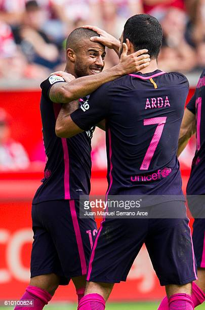 Rafinha of FC Barcelona celebrates with his teammates Arda Turan of FC Barcelona after scoring his team's second goal during the La Liga match...