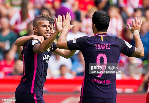 Rafinha of FC Barcelona celebrates with his teammates Luis Suarez of FC Barcelona after scoring his team's second goal during the La Liga match...