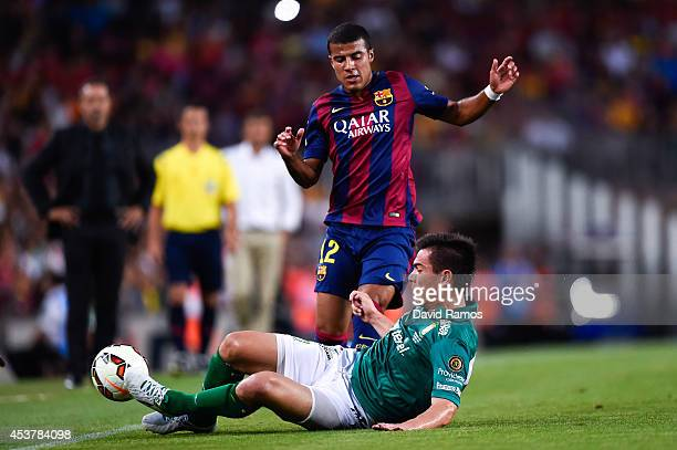 Rafinha of FC Barcelona competes for the ball with Ignacio Gonzalez of Club Leon during the Joan Gamper Trophy match between FC Barcelona and Club...