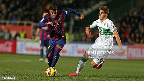 Rafinha of FC Barcelona competes for the ball with Pasalic of Elche FC during the La Liga match between Elche FC and FC Barcelona at Estadio Manuel...