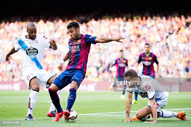 Rafinha of FC Barcelona controls the ball between Sidnei and Alberto Lopo of RC Deportivo La Coruna during the La Liga match between FC Barcelona and...