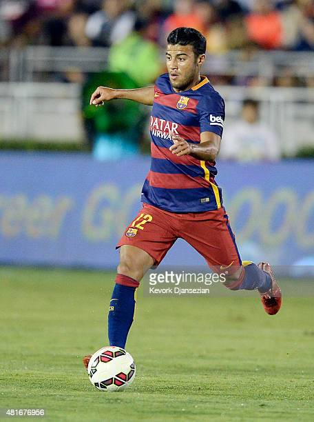Rafinha of FC Barcelona drives the ball during the first half of friendly soccer match against Los Angeles Galaxy in the International Champions Cup...