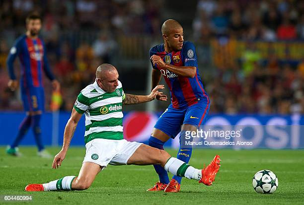 Rafinha of FC Barcelona is tackled by Scott Brown of Celtic FC during the UEFA Champions League Group C match between FC Barcelona and Celtic FC at...