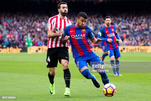 Rafinha of FC Barcelona protects the ball from Mikel Balenziaga of Athletic Club during the La Liga match between FC Barcelona and Athletic Club at...