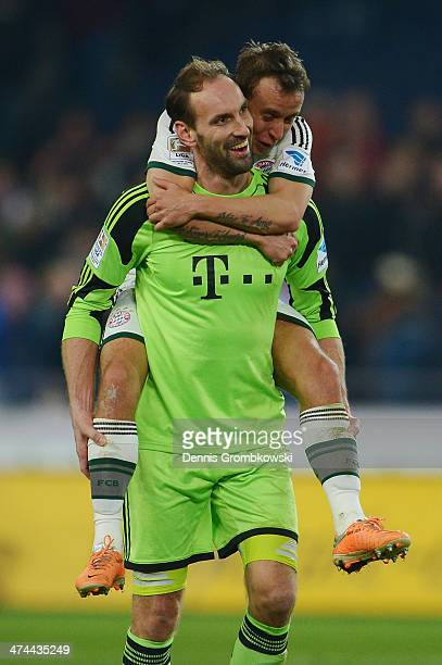 Rafinha of FC Bayern Muenchen celebrates with team mate Tom Starke after the Bundesliga match between Hannover 96 and FC Bayern Muenchen at HDI-Arena...